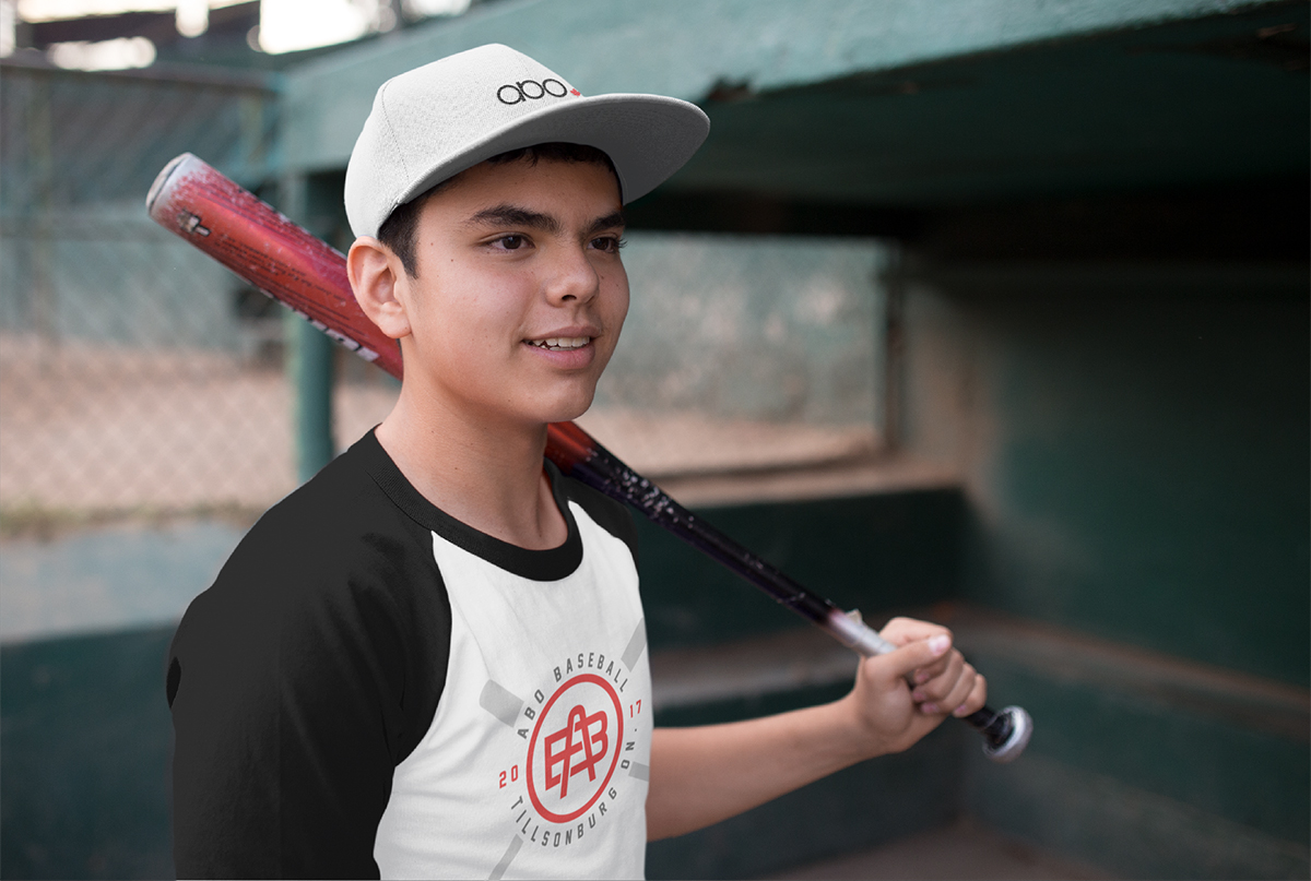 kid-wearing-a-baseball-hat-mockup-and-raglan-t-shirt-while-holding-a-bat-a15172-2